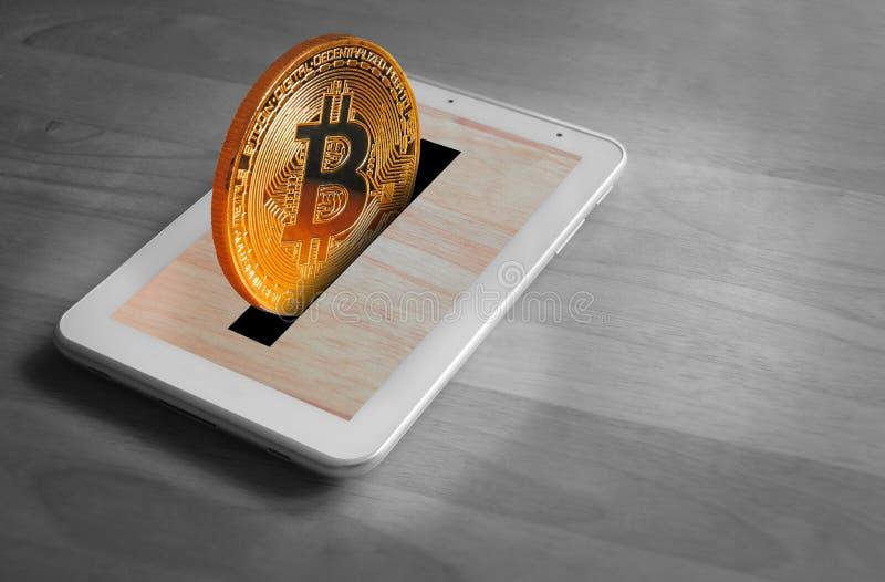 Ταμπλέτα Bitcoin moneybox στοκ εικόνες