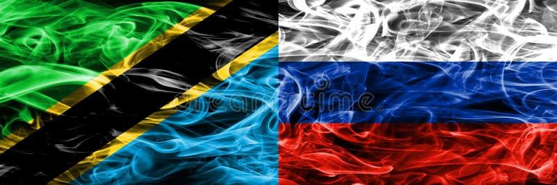 Τανζανία εναντίον της Ρωσίας, ρωσικές σημαίες καπνού που τοποθετούνται δίπλα-δίπλα Πυκνά χρωματισμένες μεταξωτές σημαίες καπνού τ απεικόνιση αποθεμάτων