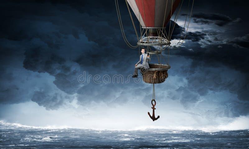 Ταξίδι επιχειρηματιών στο μπαλόνι αέρα στοκ εικόνα