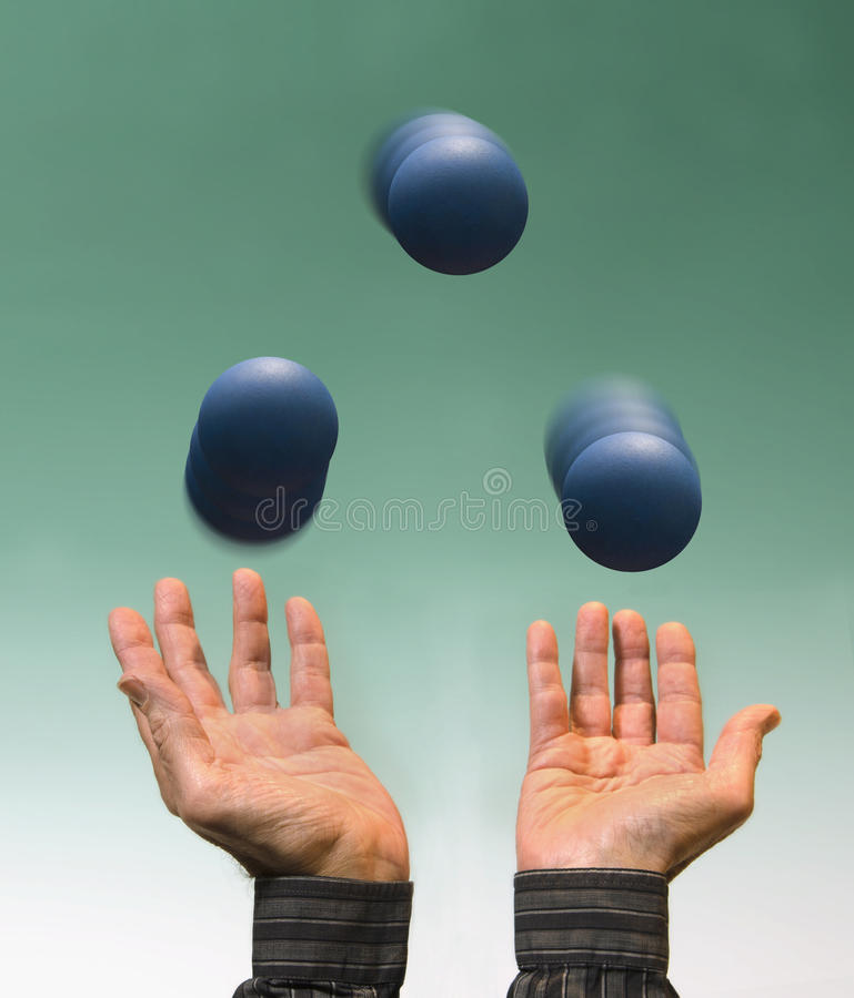 Ταχυδακτυλουργία τριών μπλε σφαιρών στοκ φωτογραφίες