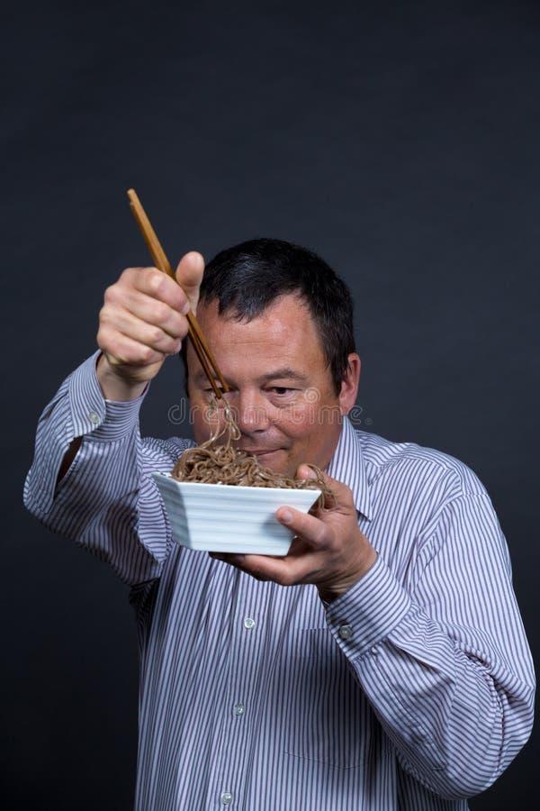 Ταϊσμένος επάνω με chopsticks στοκ εικόνα