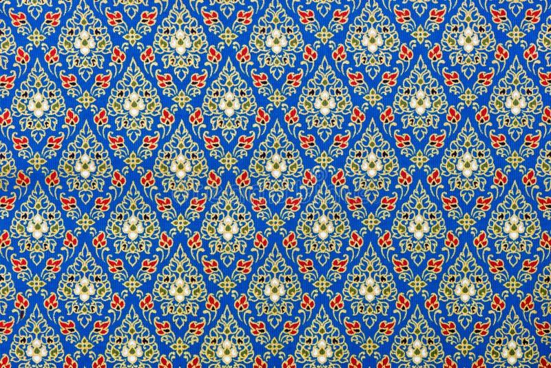 Ταϊλανδικά σχέδια μπλε και χρυσός στο ύφασμα μεταξιού στοκ εικόνα
