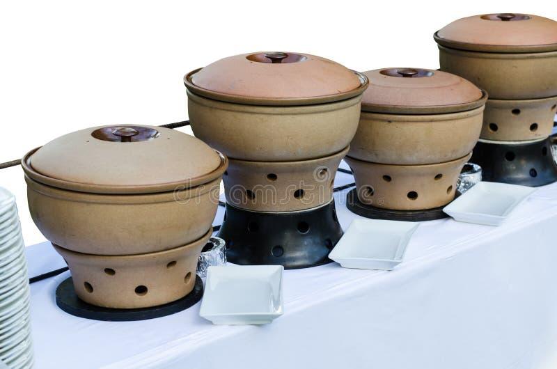 Ταϊλανδικές θερμάστρες πιάτων σκαρών αγγειοπλαστικής αργίλου στοκ εικόνα με δικαίωμα ελεύθερης χρήσης