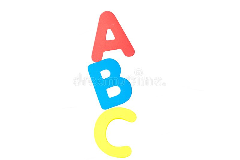 Τα αγγλικά σύμφωνα Α Β Γ είναι σε ένα άσπρο υπόβαθρο στοκ φωτογραφία
