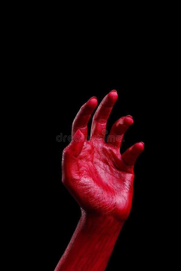 Τα ανθρώπινα χέρια που χρωματίζονται στο κόκκινο θέτουν σε ένα μαύρο υπόβαθρο ημερολογιακής έννοιας ημερομηνίας ο απαίσιος μικροσ στοκ εικόνες