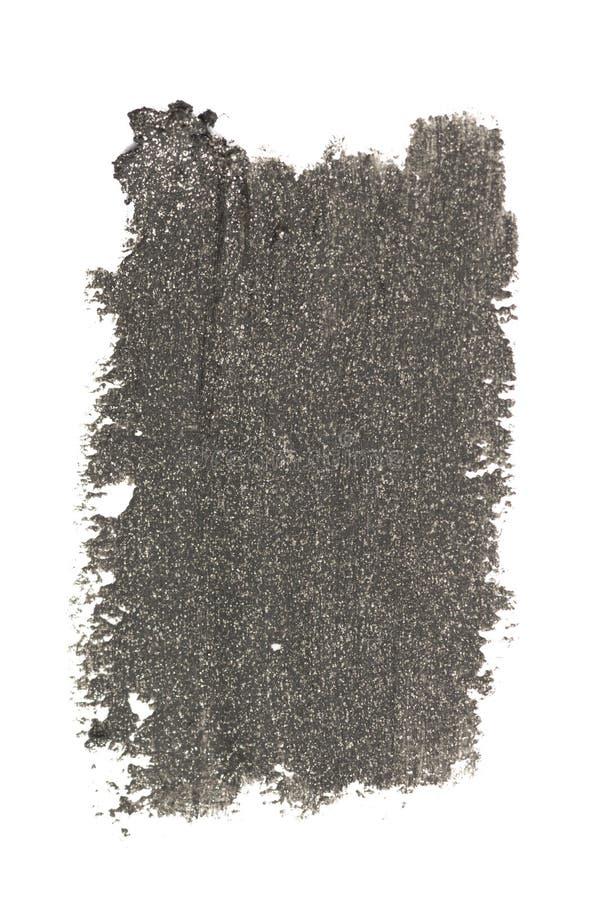 Τα ανοικτό γκρι κτυπήματα μολυβιών eyeliner χρώματος καλλυντικά με ακτινοβολούν μόρια, δείγμα προϊόντων ομορφιάς που απομονώνεται στοκ φωτογραφία με δικαίωμα ελεύθερης χρήσης