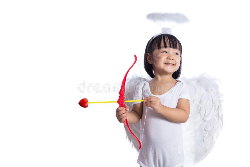 Τα ασιατικά κινέζικα λίγο cupid με το τόξο και το βέλος στοκ εικόνες