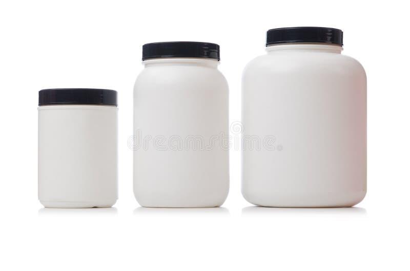 Τα βάζα με την πρωτεΐνη πρόσθετων ουσιών τροφίμων που απομονώνεται επάνω στοκ εικόνες