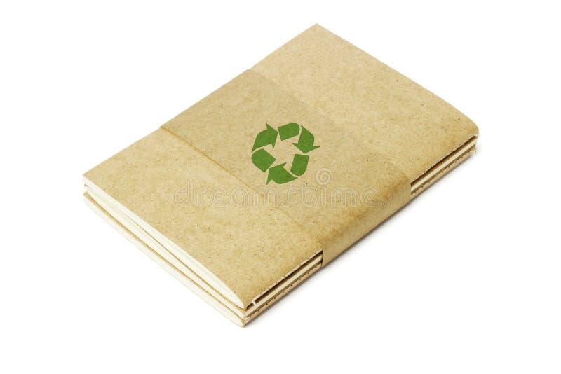 τα βιβλία που ανακυκλώνονται ράβουν το νήμα συμβόλων στοκ φωτογραφία με δικαίωμα ελεύθερης χρήσης