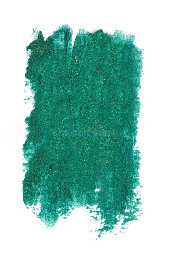 Τα δασικά πράσινα κτυπήματα μολυβιών eyeliner χρώματος καλλυντικά με ακτινοβολούν μόρια, δείγμα προϊόντων ομορφιάς που απομονώνετ στοκ φωτογραφία
