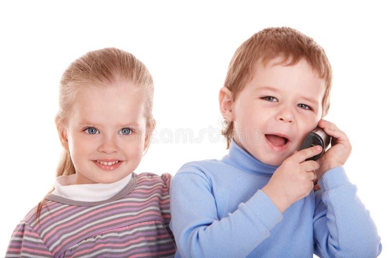 τα επιχειρησιακά παιδιά ταιριάζουν το τηλέφωνο στοκ φωτογραφίες