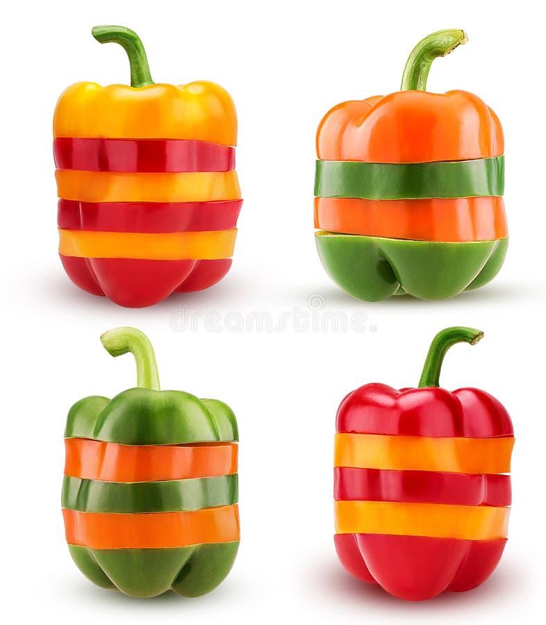Τα καθορισμένα πιπέρια κουδουνιών τεμαχίζουν τα κόκκινα, κίτρινα, πράσινα, πορτοκαλιά χρώματα στοκ φωτογραφία