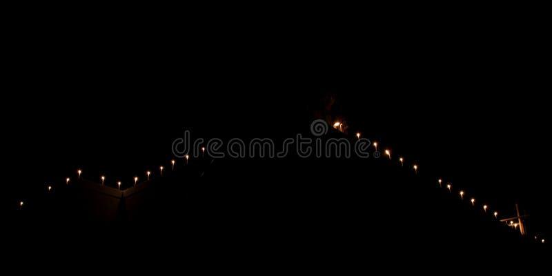 Τα κεριά φλογών θεωρούν την έννοια Κεριά σε μια σειρά στοκ φωτογραφίες