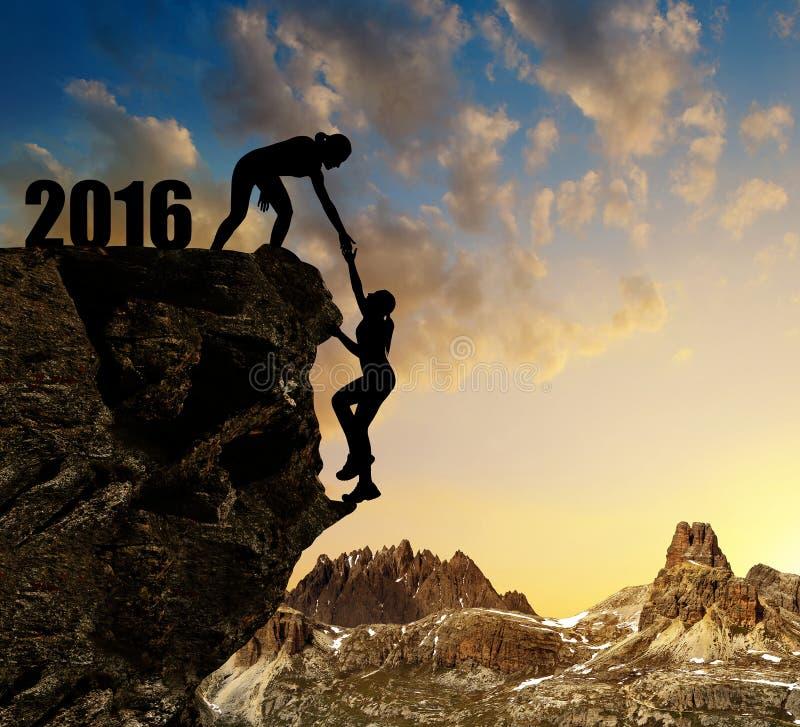 Τα κορίτσια αναρριχούνται στο νέο έτος 2016 στοκ φωτογραφίες