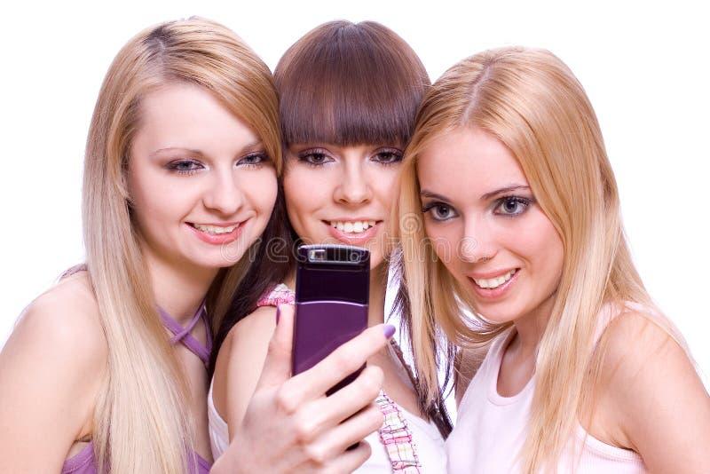 τα κορίτσια τηλεφωνούν σε τρία στοκ εικόνες