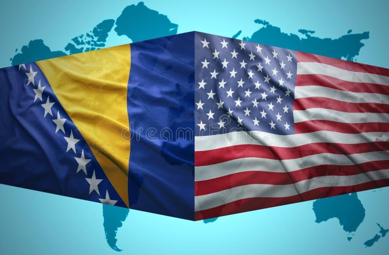 Τα κυματίζοντας βοσνιακά και αμερικανικές σημαίες στοκ εικόνες