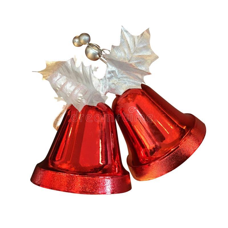 Τα κόκκινα κουδούνια Χριστουγέννων με τα ασημένια φύλλα διακοσμούν το isol διακοσμήσεων στοκ εικόνες