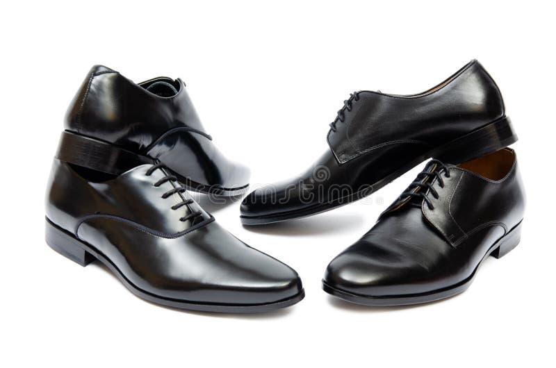 Τα μαύρα παπούτσια στο άσπρο υπόβαθρο στοκ φωτογραφίες με δικαίωμα ελεύθερης χρήσης