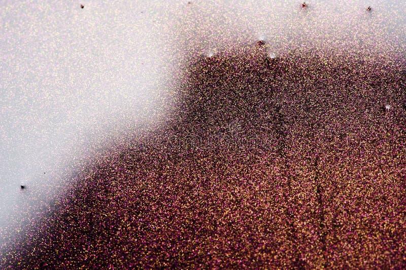 Τα μόρια ακτινοβολούν καφετιά υλικό και πετρέλαιο στοκ εικόνες