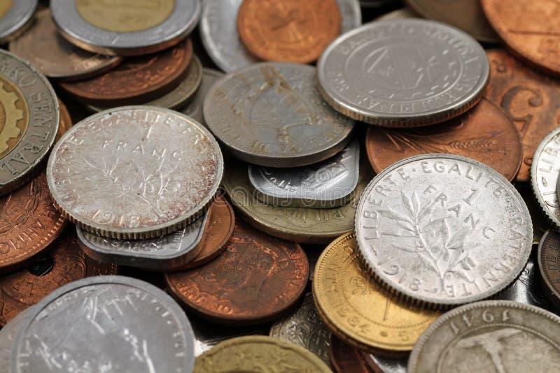 Τα ξένα νομίσματα κλείνουν επάνω στοκ φωτογραφία