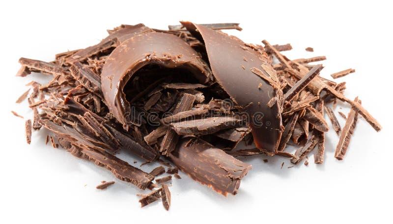 Τα ξέσματα σοκολάτας σε ένα άσπρο υπόβαθρο στοκ εικόνα