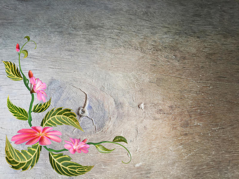 Τα λουλούδια και τα πράσινα φύλλα με ξύλινο στοκ φωτογραφία