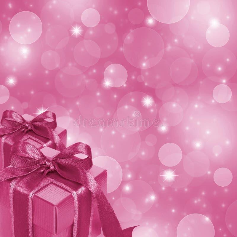 Τα ρόδινα κιβώτια δώρων ακτινοβολούν επάνω ανασκόπηση απεικόνιση αποθεμάτων