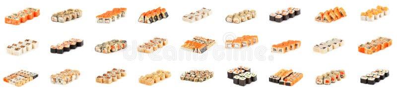 Τα σούσια κυλούν - συλλογή κομματιών σουσιών της Maki με τα αυγοτάραχα σολομών, καπνισμένο χέλι, αγγούρι, τυρί κρέμας, σουσάμι, α στοκ φωτογραφίες με δικαίωμα ελεύθερης χρήσης