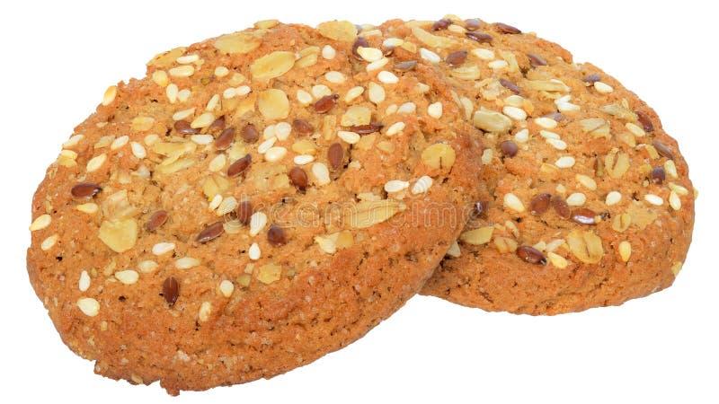 Τα στρογγυλά μπισκότα δημητριακών με τους σπόρους ηλίανθων και τις νιφάδες βρωμών απομονώνουν στοκ φωτογραφία