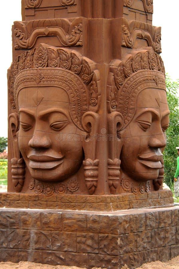 Τα τέσσερα πρόσωπα του αγάλματος buddah στον ψαμμίτη Καμπότζη penh phnom στοκ φωτογραφίες με δικαίωμα ελεύθερης χρήσης