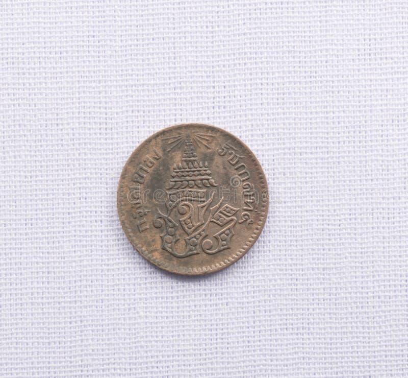 Τα ταϊλανδικά νομίσματα νομίσματος έχουν χρησιμοποιηθεί ένα εκατό πριν από χρόνια στοκ εικόνα