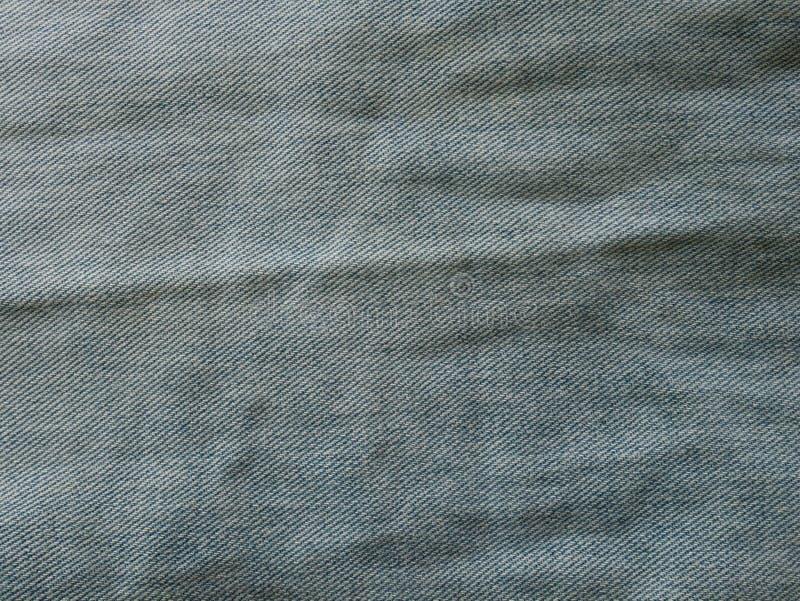 Τα τζιν στο μπλε πλυσίματος με σχίζουν Υπόβαθρο τζιν, σύσταση Σχισμένος Οργανικός, σχέδιο στοκ εικόνα