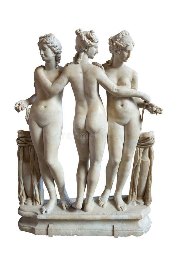 Τα τρία κοσμούν το γλυπτό - μουσείο του Λούβρου, Παρίσι - Γαλλία στοκ εικόνες