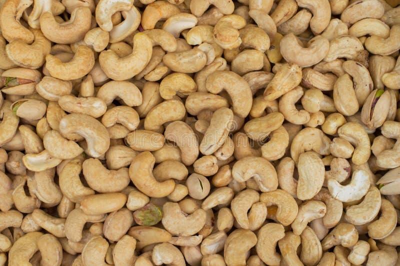 Τα δυτικά ανακάρδια πλούσια σε φιλικά λιπαρά οξέα καρδιών τρόφιμα υγιή Καρύδια των δυτικών ανακαρδίων ως υπόβαθρο τροφίμων Τοπ όψ στοκ φωτογραφία με δικαίωμα ελεύθερης χρήσης