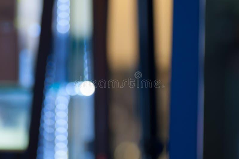 Τα φω'τα Defocused αφαιρούν το μπλε υπόβαθρο στοκ εικόνα με δικαίωμα ελεύθερης χρήσης
