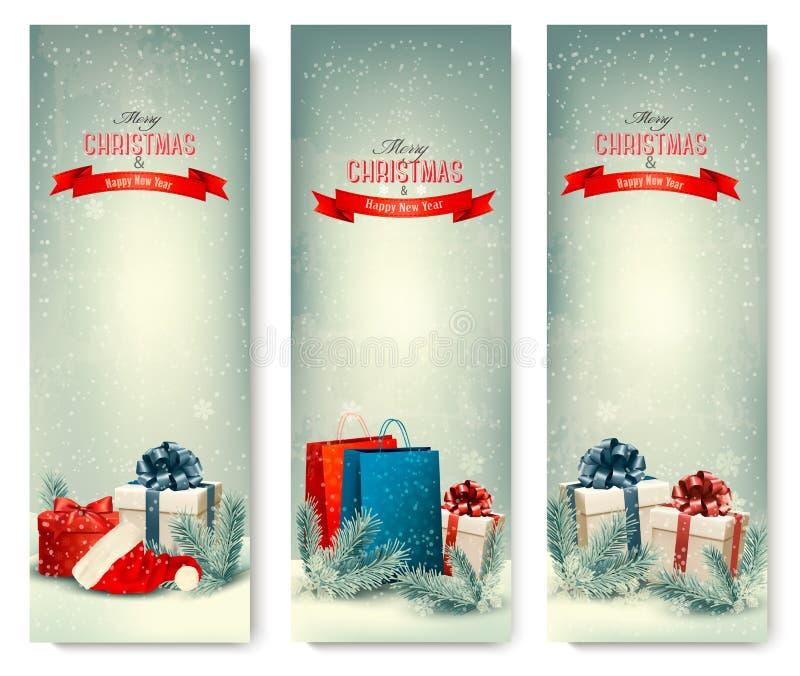 Τα χειμερινά εμβλήματα Χριστουγέννων με παρουσιάζουν. απεικόνιση αποθεμάτων
