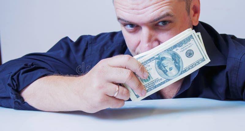 Τα χρήματα είναι το καλύτερο κίνητρό μου Επιχειρηματίας που εργάζεται για τα χρήματα στοκ φωτογραφία με δικαίωμα ελεύθερης χρήσης