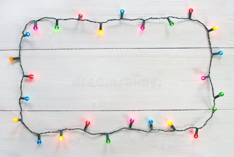 Τα Χριστούγεννα ανάβουν το πλαίσιο στοκ εικόνα με δικαίωμα ελεύθερης χρήσης