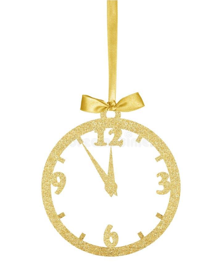 Τα χρυσά Χριστούγεννα ακτινοβολούν διακοσμητικό ρολόι στην κορδέλλα που απομονώνεται επάνω στοκ φωτογραφία με δικαίωμα ελεύθερης χρήσης
