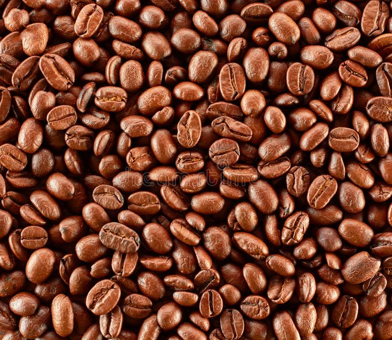 Τα ψημένα φασόλια καφέ, μπορούν να χρησιμοποιηθούν ως ανασκόπηση στοκ φωτογραφία με δικαίωμα ελεύθερης χρήσης