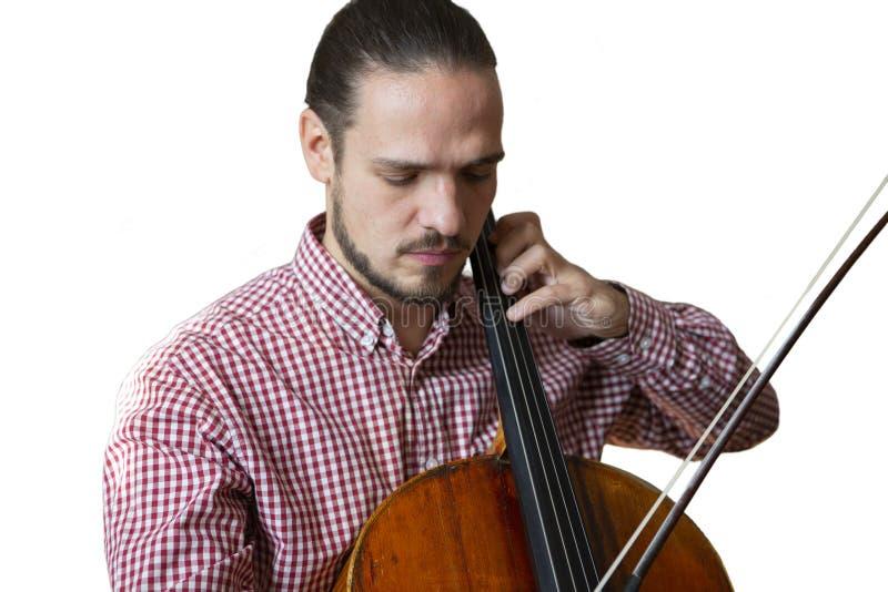 Τα όργανα ορχηστρών χεριών βιολοντσελιστών παιχνιδιού βιολοντσέλων κοντά επάνω απομόνωσαν την εικόνα στο άσπρο υπόβαθρο στοκ φωτογραφία με δικαίωμα ελεύθερης χρήσης