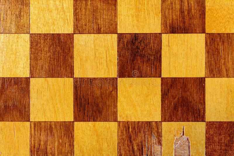 Τεμάχιο μιας παλαιάς ξύλινης κινηματογράφησης σε πρώτο πλάνο πινάκων σκακιού αφηρημένη ανασκόπηση στοκ εικόνα με δικαίωμα ελεύθερης χρήσης