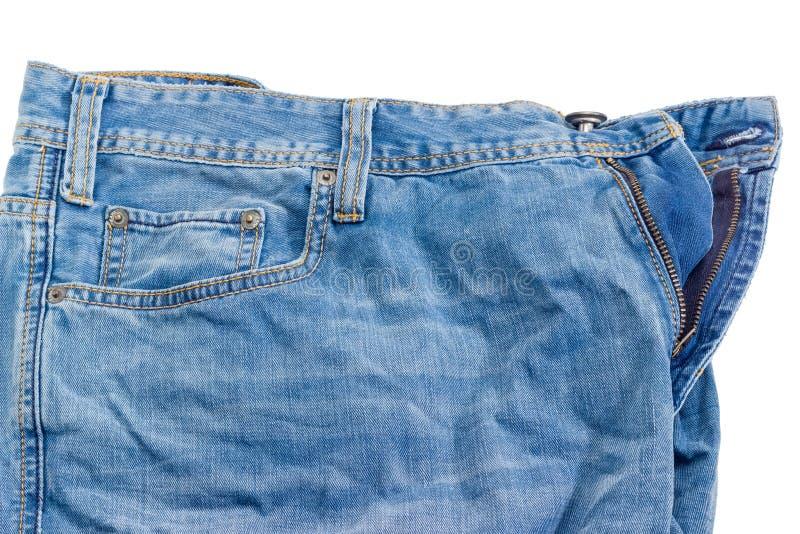 Τεμάχιο του χρησιμοποιημένου τσαλακωμένου τζιν παντελόνι στο άσπρο υπόβαθρο στοκ εικόνες με δικαίωμα ελεύθερης χρήσης