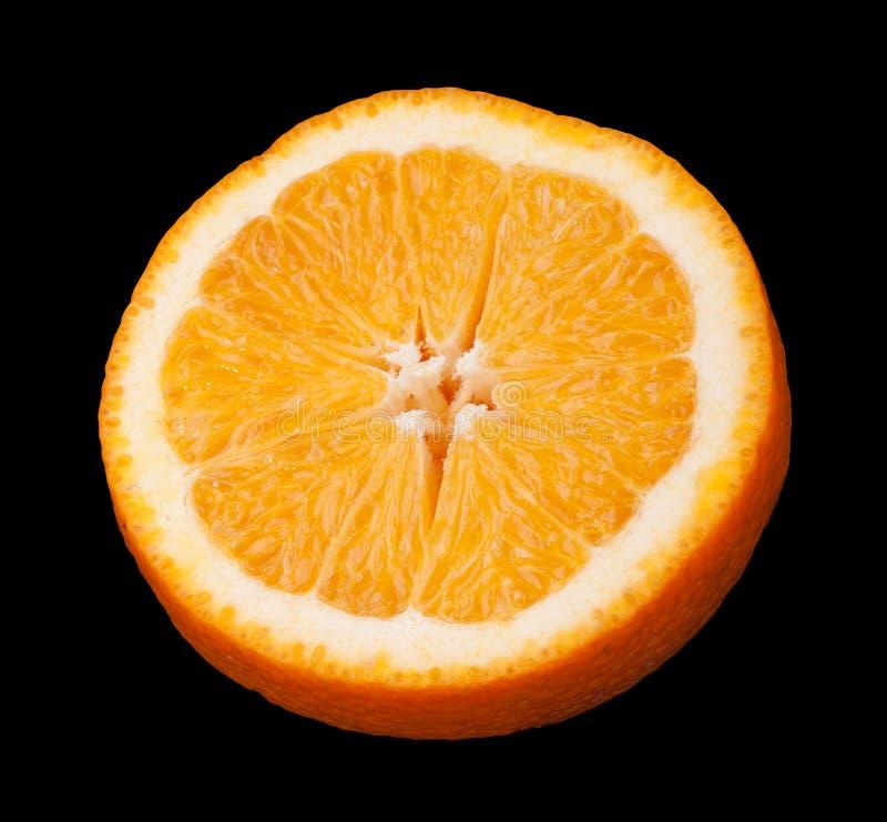 Τεμαχισμένα πορτοκαλιά φρούτα στο Μαύρο στοκ φωτογραφίες με δικαίωμα ελεύθερης χρήσης