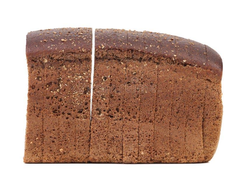 Τεμαχισμένη φραντζόλα του καφετιού ψωμιού στοκ εικόνες