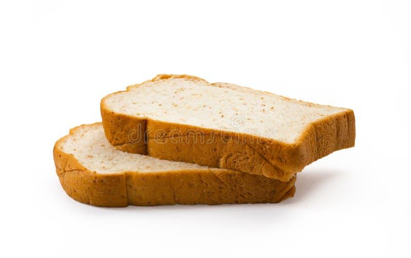 Τεμαχισμένο ψωμί που απομονώνεται στην άσπρη ανασκόπηση στοκ εικόνες