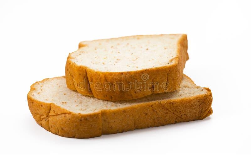 Τεμαχισμένο ψωμί που απομονώνεται στην άσπρη ανασκόπηση στοκ φωτογραφίες
