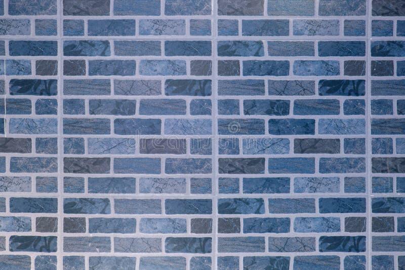 Τετραγωνικές υπόβαθρο και σύσταση φραγμών τούβλου στοκ φωτογραφία