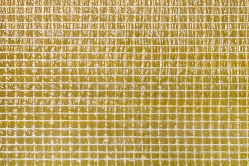 Τετραγωνικό γεωμετρικό υπόβαθρο σύστασης ταινιών μωσαϊκών κίτρινο Στρώμα στεγανοποίησης του δομικού υλικού Υγρό υλικό σειράς μαθη στοκ εικόνες