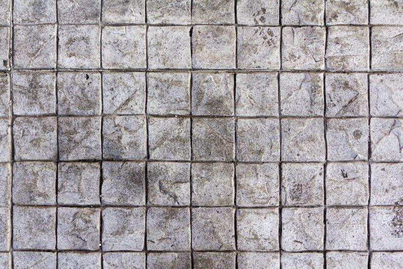 Τετραγωνικό υπόβαθρο τσιμεντένιων ογκόλιθων στοκ εικόνες
